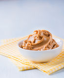 Creamy peanut butter in white bowl Stock Photos
