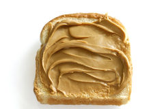 Creamy peanutbutter on white bread Royalty Free Stock Photo