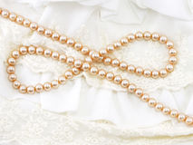 Creamy pearl necklace on a lace background Stock Images