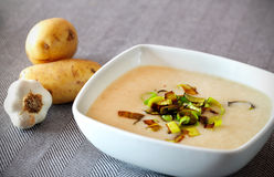 Creamy potato soup with fried leek Royalty Free Stock Images