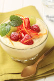 Creamy pudding with fresh fruit Stock Image