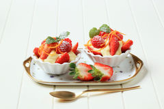 Creamy pudding and fresh fruit. In small dessert dishes Royalty Free Stock Photos