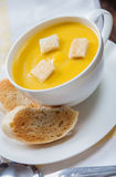 Creamy pumpkin soup with croutons and lightly toas Stock Photo