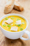 Creamy pumpkin soup with croutons and lightly toasted baguette Stock Photo