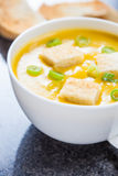 Creamy pumpkin soup with croutons and lightly toasted baguette Royalty Free Stock Photo