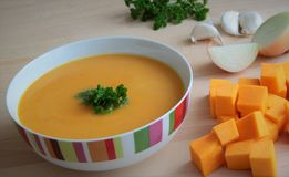 Creamy pumpkin soup. Creamy pumpkin soup with garlic, parsley and coconut milk Royalty Free Stock Photos