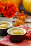 Creamy pumpkin soup on red table cloth Royalty Free Stock Image