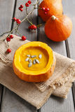 Creamy pumpkin soup on rustic wooden table. Healthy food Royalty Free Stock Images