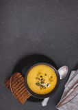 Creamy pumpkin and sweet potato soup with herbs Royalty Free Stock Photos