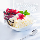Creamy rice dessert with berries Stock Photos