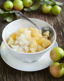 Creamy rice pudding with apple and cinnamon Stock Image