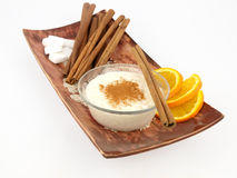 Creamy rice pudding with cinnamon and orange Royalty Free Stock Photos