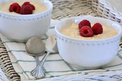 Creamy rice pudding with raspberries Stock Images
