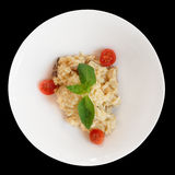 Creamy risotto in porcelain plate isolated on black Stock Photo