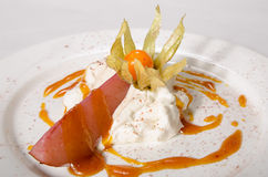 Creamy sauce with tomato and baked apple on white plate. Deliciously Stock Images