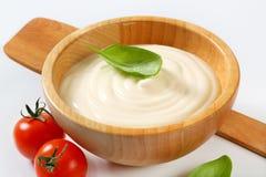 Creamy sauce in wooden bowl Stock Photos