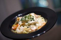 Creamy seafood Fettuccine alfredo pasta dish Royalty Free Stock Photo