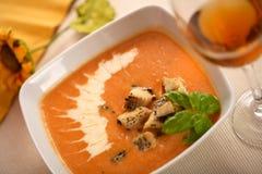 Creamy soup with basil Stock Photos
