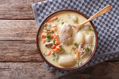 Creamy soup with chicken and vegetables close up. Horizontal top. Creamy soup with chicken and vegetables close up in a bowl on the table. Horizontal view from Royalty Free Stock Image