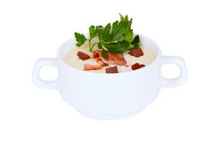 Creamy soup with croutons and bacon parsley in tureen Stock Image