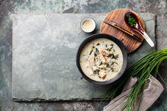 Creamy soup with Eel in black iron pot Royalty Free Stock Images