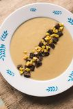 Baked garlic soup with smoked beer stock image