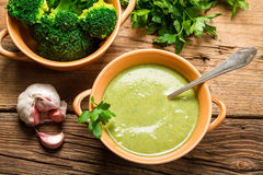 Creamy soup made of fresh broccoli and parsley Stock Photos