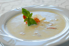 Creamy soup with seafood Stock Photos