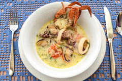 Creamy soup with seafood Stock Photo