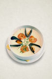 Creamy soup with seafood. shrimp, mussels Stock Image