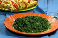 Creamy Spinach. In an orange plate Royalty Free Stock Photography