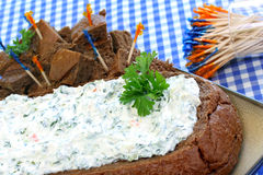 Creamy Spinach Dip in Bread Loaf. Creamy spinach dip in a loaf of rye pumpernickel bread with cubes on the side.  Close up view Stock Photography