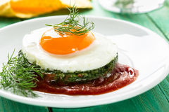 Creamy spinach with fried egg Royalty Free Stock Image