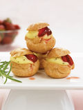 Creamy strawberry choux puffs Royalty Free Stock Photos
