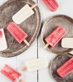 Creamy and strawberry popsicles Royalty Free Stock Image