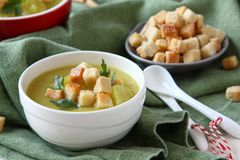 Creamy sweet potato soup with croutons and parsley in white bowl Stock Photo