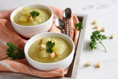 Creamy sweet potato soup with croutons and parsley in white bowl Royalty Free Stock Photo
