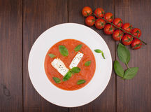 Creamy tomato and lentil soup with feta. Tomato cherry Royalty Free Stock Images