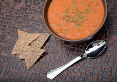 Creamy tomato soup and chips Stock Photography