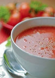 Creamy tomato soup in white bowl Stock Photo