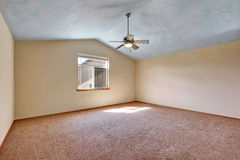 Creamy tones empty room with vaulted ceiling Stock Images