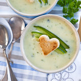 Creamy vegetable soup. With fresh cucumber and toasted bread Stock Photo