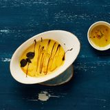 Creamy vegetable soup in oval plate. Cracker, thyme and quail egg on blue aged wooden surface. Delicious gourmet restaurant dish, tasty vegetarian daily meal Stock Images