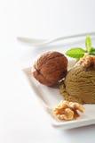 Creamy walnut icecream with nuts Stock Photos