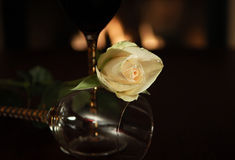 Creamy white rose with wine glass Stock Photos