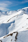 Creamy winter landscape. Creamy snow hills in the alps Stock Images