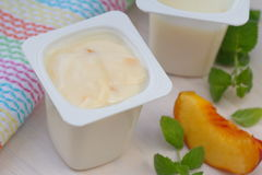 Creamy yogurt with peach Royalty Free Stock Photography