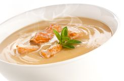 Crean soup. Delicious and hot salmon cream soup royalty free stock photo
