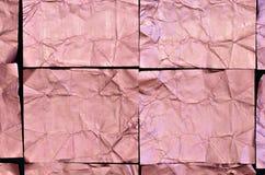 Creased розовые квадраты алюминиевой фольги на черной предпосылке Стоковая Фотография