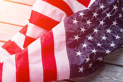 Creased American flag in sunlight. Stock Photography